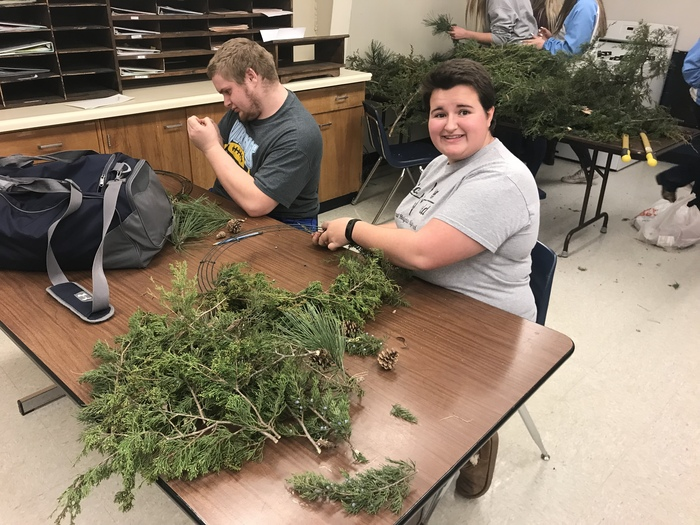 Mya and Jonathan busy making Christmas wreaths in Horticulture.