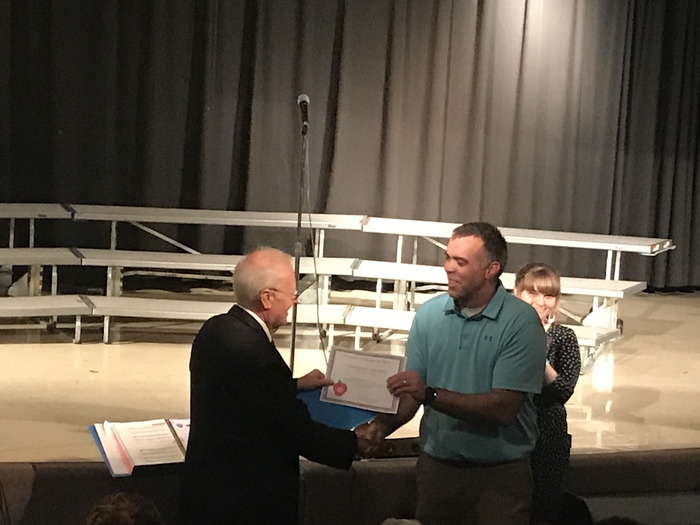 Mr. Jim Porter presents Mr. Matile with the Challenge Award.